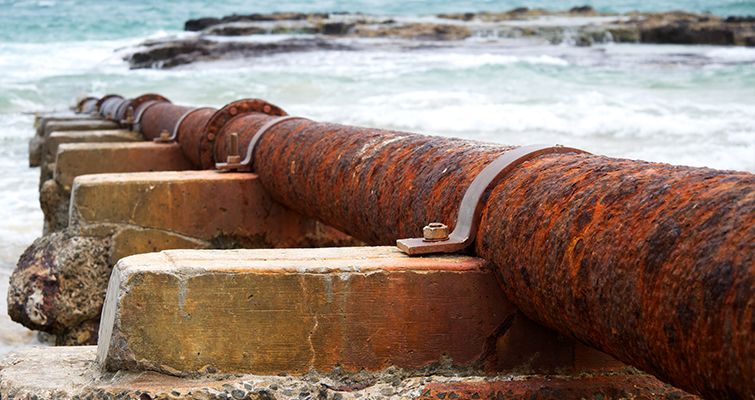 Rusted Pipes on the Shore