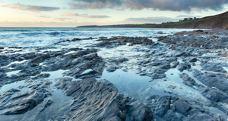 Rocky Beach Covered by a Flowing Tide